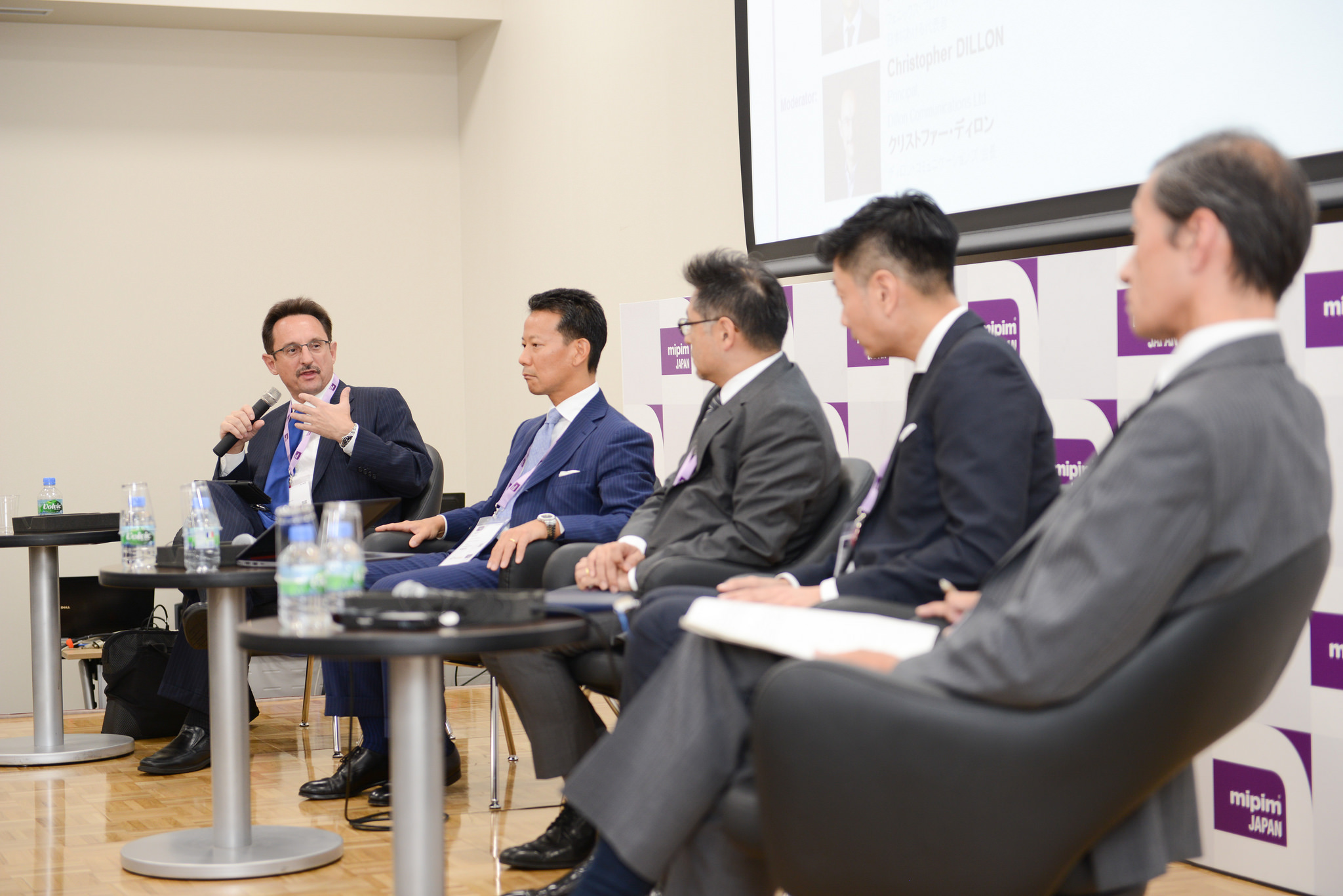 Christopher Dillon moderates a panel discussion at MIPIM Japan