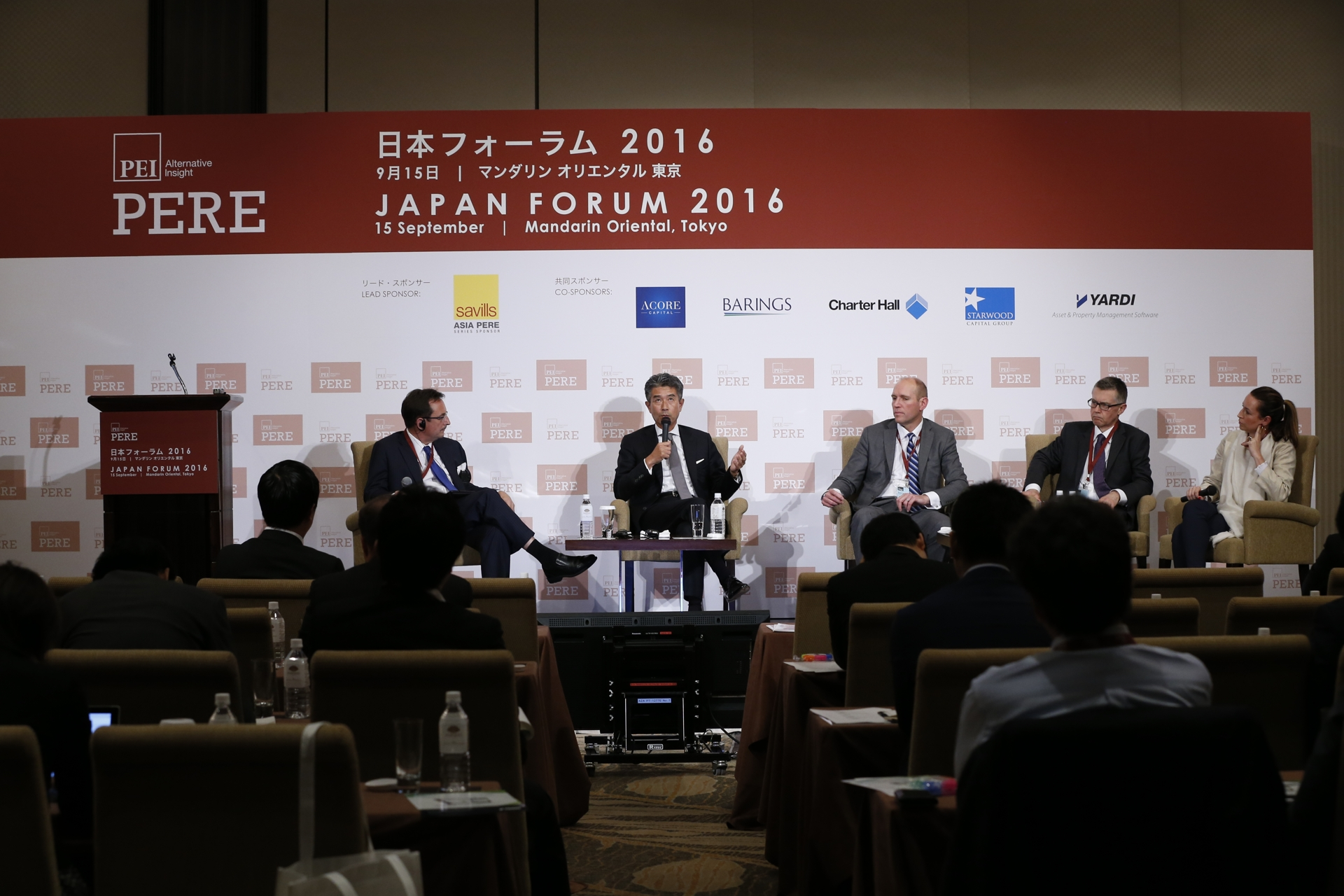 Christopher Dillon moderates a panel discussion at the PERE Japan Forum