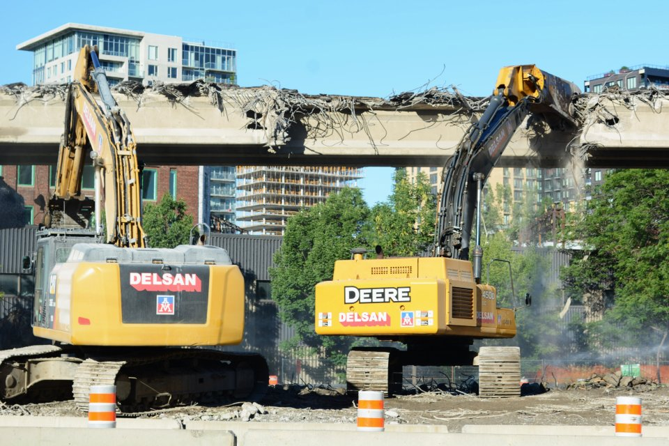 Workers demolish a freeway in Montreal in 2016